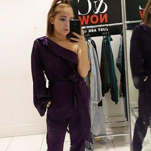 A purple jumpsuit